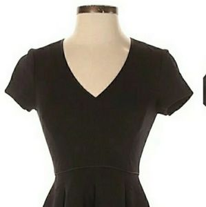 Fit and flare black dress.